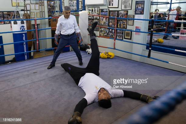 London Mayor Sadiq Khan and Olympic silver medalist, turned pro, Joe Joyce take part in a photocall in the ring at Earlsfield Amateur Boxing Club on...