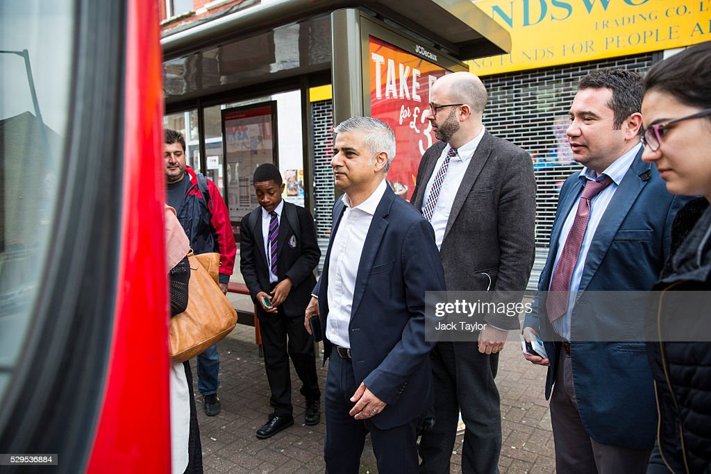 London Mayor Sadiq Khan boards a bus stop after leaving his home in Tooting on May 9, 2016 in London, England. Mr Khan begins his first day at his City Hall office after winning the race to become London's Mayor with 56.8% of the vote.