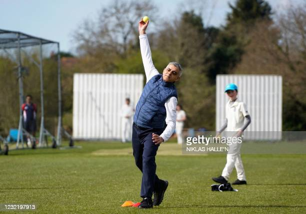 London Mayor Sadiq Khan bowls as he plays cricket during a London mayoral election campaign visit to Kingstonian Cricket Club in south-west London on...