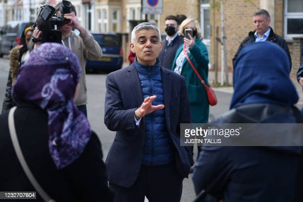 London Mayor Sadiq Khan chats to locals as he campaigns ahead of the London mayoral election, in Waltham Forest, northeast London on May 5, 2021. -...
