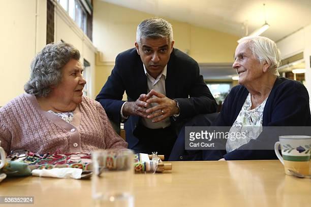 London mayor Sadiq Khan chats with 92 yearold Dorothy Wheelwright and 83 yearold Joyce Somerville during a visit to Age UK Lewisham and Southwark...