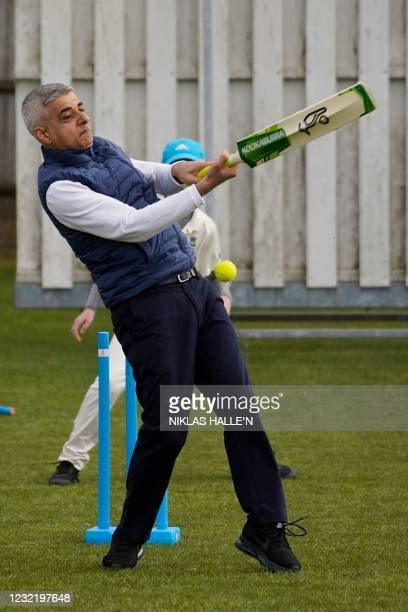 London Mayor Sadiq Khan faces a delivery as he plays cricket during a London mayoral election campaign visit to Kingstonian Cricket Club in...