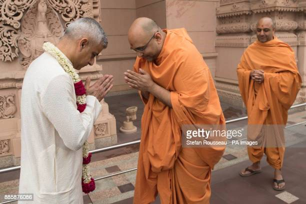 London Mayor Sadiq Khan greets sadhus holy men during a visit to Akshardham Temple in Delhi as part of his fourday trip to India It was built by the...
