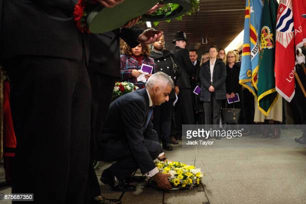 London Mayor Sadiq Khan lays a wreath during a memorial to mark the 30th anniversary of the King's Cross fire at King's Cross Station on November 18...