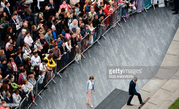 TOPSHOT London Mayor Sadiq Khan leads a vigil in Potters Fields Park in London on June 5 2017 to commemorate the victims of the terror attack on...