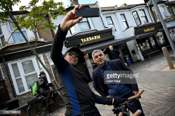 London Mayor Sadiq Khan poses for a selfie as he campaigns in Leyton on May 5, 2021 in London, England. Local elections are due to be held across the...