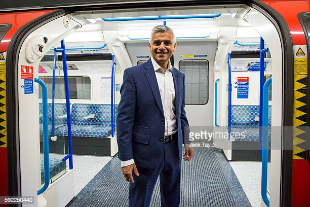 London Mayor Sadiq Khan poses in front of the open doors of a train car during the first Night Tube train to leave from Brixton Underground Station...