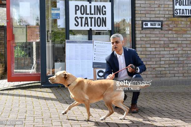 London Mayor Sadiq Khan poses with his dog Luna on his arrival at a polling station in London to cast his vote in local elections on May 6, 2021. -...