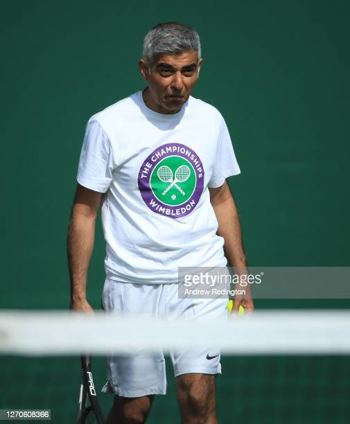 London Mayor Sadiq Khan reacts as he plays tennis with key workers at the All England Lawn Tennis Club at Wimbledon on September 04, 2020 in London,...