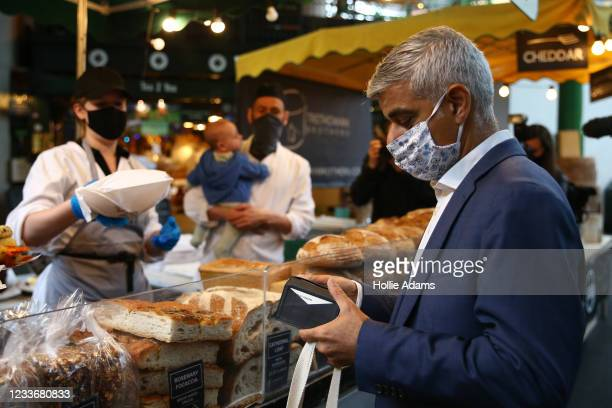 London Mayor Sadiq Khan shops during a visit to Borough Market on June 27, 2021 in London, England. Khan visited London's Borough Market as it opened...