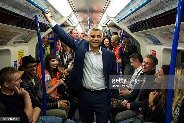 London Mayor Sadiq Khan stands between passengers in the first Night Tube train along the Victoria line on August 20 2016 in London England The...