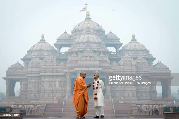 London Mayor Sadiq Khan talks with Swami Sadhu Gnanmunidas during a visit to Akshardham Temple in Delhi as part of his fourday trip to India It was...