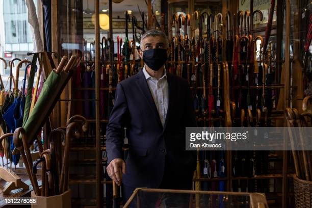 London Mayor Sadiq Khan visits James Smith & Sons Ltd, a family business selling umbrellas and walking sticks on April 13, 2021 in London, England....