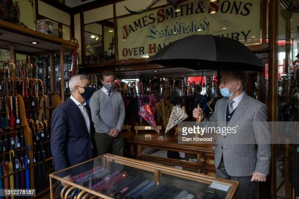 London Mayor Sadiq Khan visits James Smith & Sons Ltd, a family business selling umbrellas and walking sticks on April 13, 2021 in London, England....
