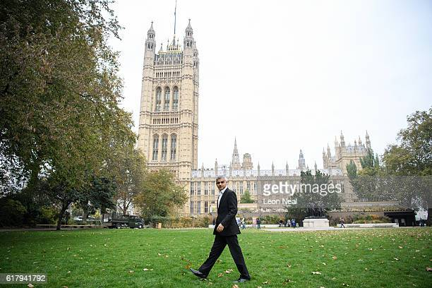 London Mayor Sadiq Khan walks past The Houses of Parliament after being interviewed at Westminster on October 25 2016 in London England Following the...