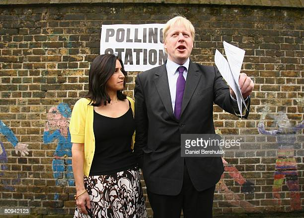 London Mayoral candidate Boris Johnson stands with wife Marina before casting his vote on May 1 2008 in London England According to reports the race...
