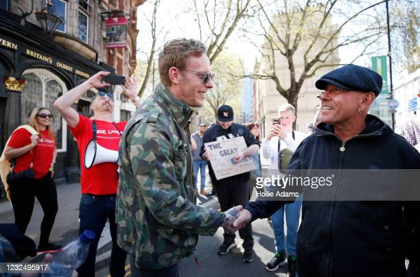 """London mayoral candidate Laurence Fox shakes hands with a protester as he attends a """"Unite For Freedom"""" anti-lockdown demonstration held to protest..."""