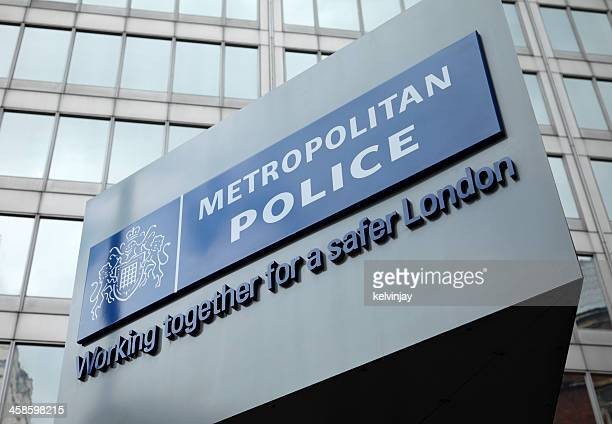 london metropolitan police sign at new scotland yard - metropolitan police stock pictures, royalty-free photos & images