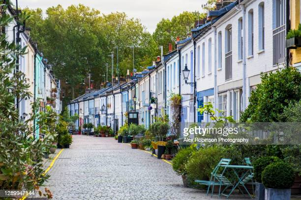 a london mews - residential street of colourful houses once used for stables and coach houses - notting hill stock pictures, royalty-free photos & images