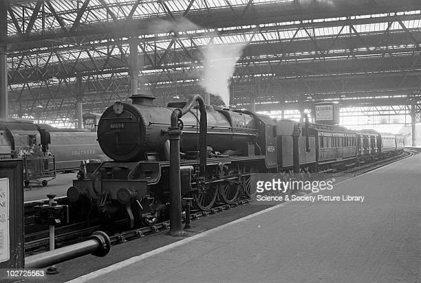 London Midland Scotland class 6P 460 no 46154 The Hussar' at Waterloo 18th June 1948