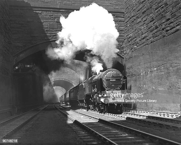 London Midland Scottish Railway Royal Scot Class steam locomotive No 6130 West Yorkshire Regiment climbing out of Liverpool Lime Street Station...