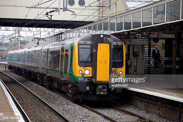 london midland train stops at milton keynes station - milton keynes stock pictures, royalty-free photos & images