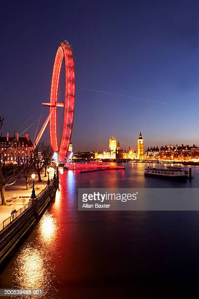 UK, London, Millennium Wheel illuminated at dusk