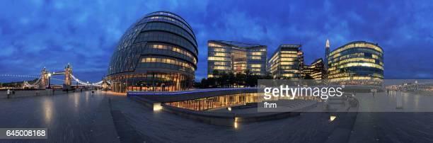 London - modern skyline panorama near Thames River at blue hour