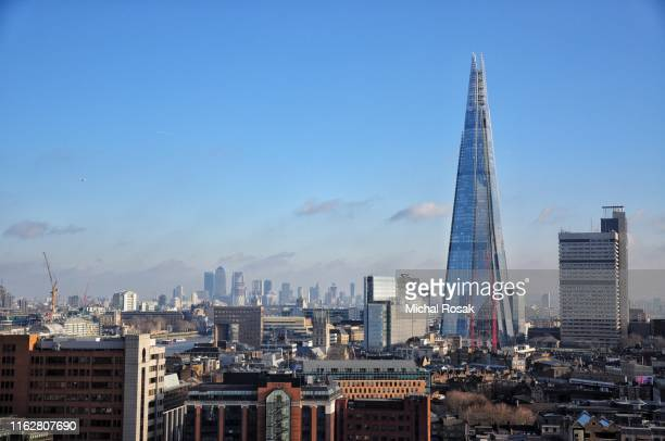 london modern skyline with canary wharf district in the background - air pollution stock pictures, royalty-free photos & images