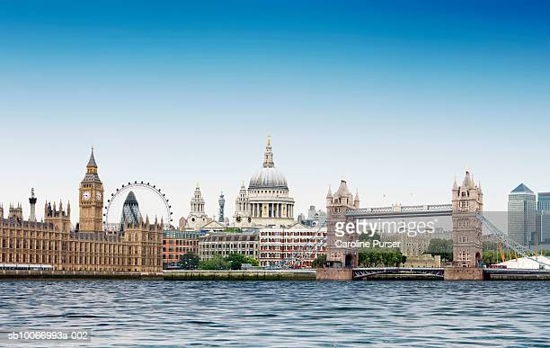 london montage against plain blue sky with river thames in foreground - day stock pictures, royalty-free photos & images