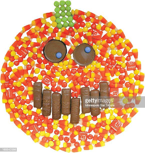 London Nelson color photo illustration of jacko'lantern made from candy corn MMs Reese's peanut butter cups and Twix bars