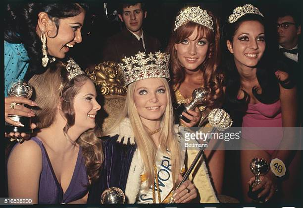 Newly crowned Miss World 1969 20yearold Eva RueberStaier receives congratulations from runnersup Gail Renshaw Christa Margraf and Marcia Rita Piazza...