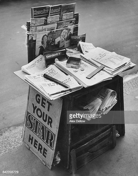 A London news stand relies on the honour system for payment circa 1950