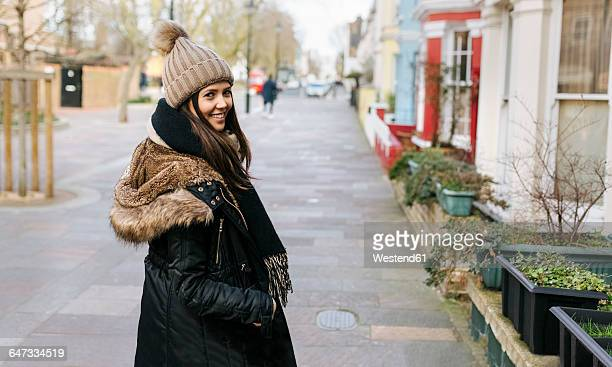 UK, London, Notting Hill, portrait of smiling young woman