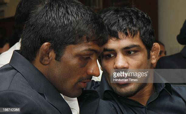 'NEW DELHI INDIA AUGUST 17 London Olympic 2012 Medalists Sushil Kumar and Yogeshwar Datt during their Felicitation at BJP leader L K Advani's...