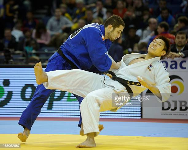London Olympic champion, Jae-Bum Kim of Korea , is swept to the mat by Adrian Nacimento Lorenzo of Spain without conceding a score, eventually...