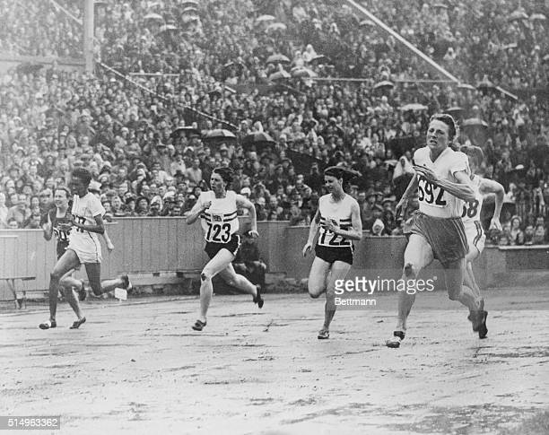 London: Olympic Games: Fanny Blankers-Koen, , 200 meters, No. 692 winning the women's 200-meters from a. D. Williamson, , No. 723, who has second and...
