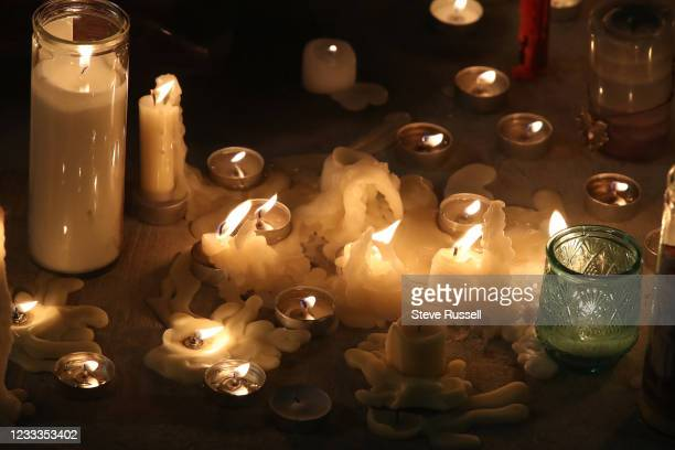 London, ON- June 8 - People return to the scene to leave flowers and light candles after a vigil for a muslim family that was killed when a 20 year...
