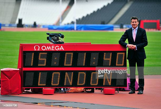 London Organising Committee of the Olympic and Paralympic Games Chairman Sebastian Coe stands next to a timing board on the track after his press...