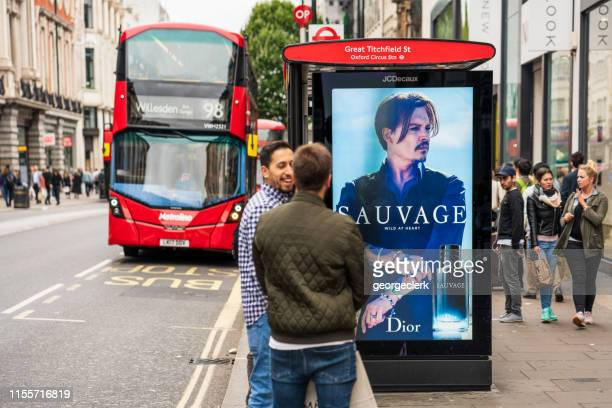 london: oxford street bus stop - oxford street london stock pictures, royalty-free photos & images