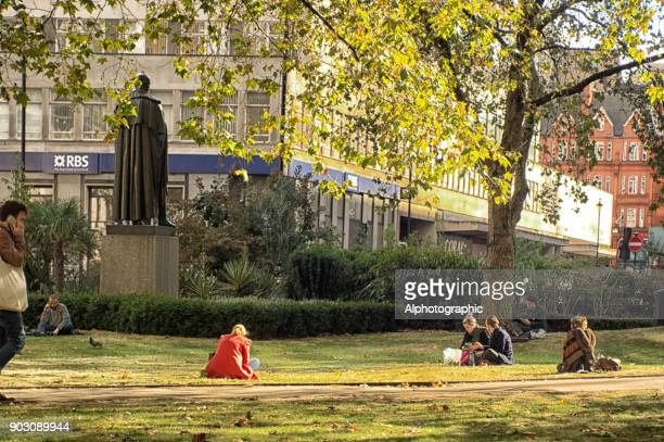 london park at lunchtime - bloomsbury london stock photos and pictures