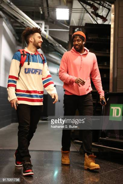 London Perrantes and John Holland of the Cleveland Cavaliers arrive before the game against the Boston Celtics on February 11 2018 at TD Garden in...
