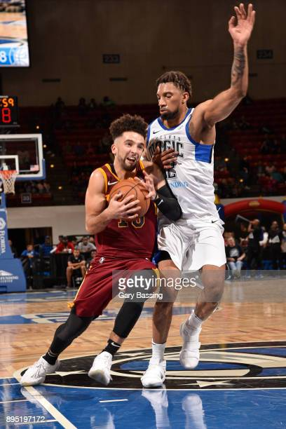 London Perrantes of the Canton Charge handles the ball against Khem Birch of the Lakeland Magic on November 10 2017 at RP Funding Center in Lakeland...