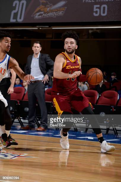 London Perrantes of the Canton Charge handles the ball against the Westchester Knicks during the game against the Canton Charge shoots against # of...