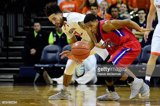 London Perrantes of the Virginia Cavaliers and Glenn Sanabria of the St Francis Brooklyn Terriers battle for a loose ball in the second half during a...