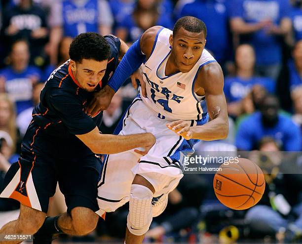 London Perrantes of the Virginia Cavaliers battles for a loose ball with Rasheed Sulaimon of the Duke Blue Devils during a game at Cameron Indoor...