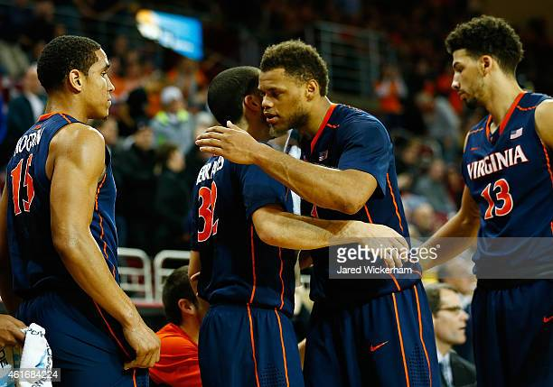 London Perrantes of the Virginia Cavaliers celebrates the win with teammates on the bench against the Boston College Eagles during the game at Conte...