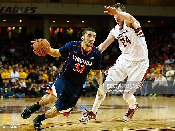 London Perrantes of the Virginia Cavaliers drives to the basket past Dennis Clifford of the Boston College Eagles in the second half during the game...