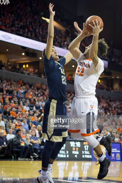 London Perrantes of the Virginia Cavaliers shoots the ball over Cameron Johnson of the Pittsburgh Panthers during a game at John Paul Jones Arena on...