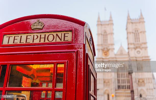 uk, london, phone booth with westminster abbey behind - telephone booth stock pictures, royalty-free photos & images